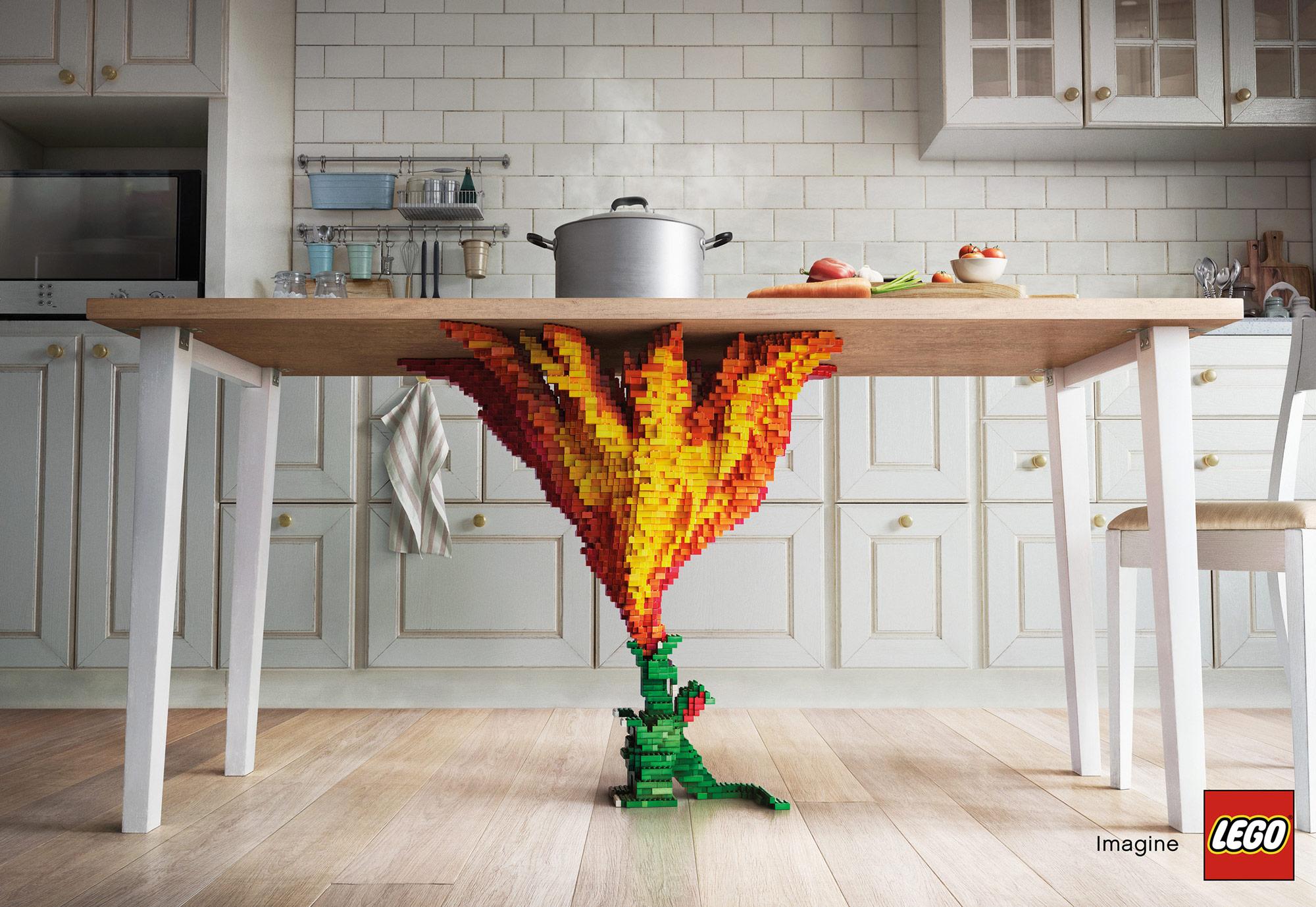 Drak, který svým ohněm zahřívá hrnec na stole